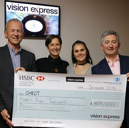 Patrick Tonks, chief executive of CHECT (left), accepts the cheque from Neil McGowan, retail and operations director at Vision Express (right), alongside senior PR manager Jenny Wye (centre left) and brand manager Ali Chaplin (centre right)